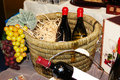 Bottles with wine in a basket Royalty Free Stock Images