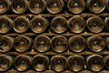 Bottles in wine cellar Stock Photography