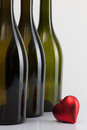 Bottles of wine and red heart empty romantic symbol Royalty Free Stock Photography