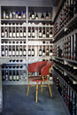 stock image of  Bottles of wine on shelves in a wine store