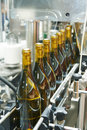 Bottling and sealing conveyor line at winery factory Royalty Free Stock Photo