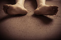 Bottom of dirty feet on ground Royalty Free Stock Photo