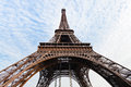 Bottom view of eiffel tower in paris with blue sky and white clouds Stock Photo