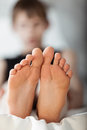 Bottom view on pair of feet Royalty Free Stock Photo