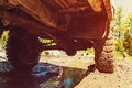 Bottom view to big offroad car wheel on country road Royalty Free Stock Photo