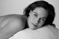 Boudoir on bed with sheet artistic conversion woman black and white Stock Image