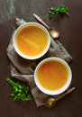 Bouillon served in two bowls Royalty Free Stock Photo