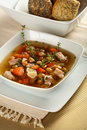 Bouillon with vegetables and meat in the plate Stock Photo