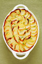 Boulangere or scalloped potatoes famous french dish so called because in the past french housewives would take this dish to be Stock Image