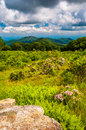 Boulder in a meadow and view of old rag mountain at thoroughfare overlook shenandoah national park virginia Royalty Free Stock Photo