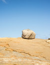 Boulder on top of a rocky hill Royalty Free Stock Images