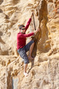 Bouldering outdoor young man rock climbing Royalty Free Stock Images