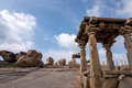 Boulders in hampi remains of temple and huge against blue sky Royalty Free Stock Image