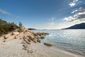 Boulders in a turquoise sea at Santa Giulia beach in Corsica Royalty Free Stock Photo