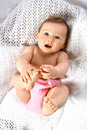 Bouncing baby play with toes Royalty Free Stock Photo