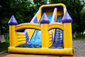 Bouncy castle slide inflatable big in a park Royalty Free Stock Photo