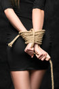 Bound hands female tied behind his back with a rope Stock Images