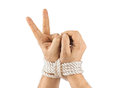 Bound hands and victory sign Royalty Free Stock Photo