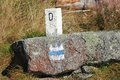 Boundary stone in the bavarian forest between germany and the czech republic Royalty Free Stock Photography