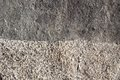 Boundary of two surfaces of natural stone as background gray spotted Royalty Free Stock Photography
