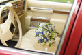 Bouquet on armrest in car wedding stylish Royalty Free Stock Photo