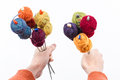 Bouquet of balls on the knitting needles many small wool all rainbowcolors by and holded in form a first person view Stock Images