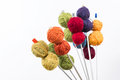 Bouquet of balls on the knitting needles many small wool all rainbowcolors by and holded in form a isolate white background Stock Images