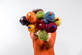 Bouquet of balls on the knitting needles many small wool all rainbowcolors by and holded in form a isolate white background Royalty Free Stock Image