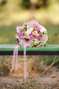 Bouquet on bench with ribbons in park Royalty Free Stock Photo