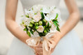 Bouquet in the bride's hands from bush roses Royalty Free Stock Photo