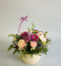 Bouquet of bright flowers in basket Royalty Free Stock Photo