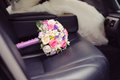 Bouquet in car wedding on leather seat Royalty Free Stock Photos
