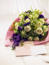 Bouquet and card in silk cloth background greeting cards Royalty Free Stock Photography
