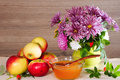 Bouquet of chrysanthemum, apples and flower honey Royalty Free Stock Photo