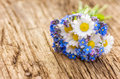 Bouquet with daisies and forget me not on a wooden background Royalty Free Stock Images