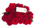 Bouquet of dark red roses with tag isolated on white background Royalty Free Stock Photos