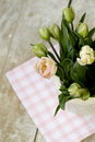 Bouquet of delicate pink tulips on the tablecloth Stock Photos