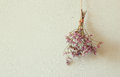 Bouquet of dried flowers hanging on rope against wooden background Royalty Free Stock Photos