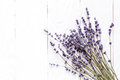 Bouquet of dried lavender on wooden table top view Royalty Free Stock Photo