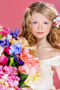 Bouquet of flowers beautiful tender girl with long curly hair holds over pink background Royalty Free Stock Photography