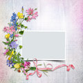 A bouquet of flowers with a frame on the vintage background and ribbon Stock Photography