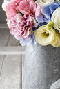 Bouquet of flowers in silver watering can Royalty Free Stock Photo
