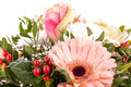 Bouquet of fresh pink and white flowers with a gerbera daisy dahlia roses in a close up view as a background for celebrating Stock Photo