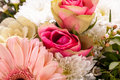 Bouquet of fresh pink and white flowers with a gerbera daisy dahlia roses in a close up view as a background for celebrating Stock Photos