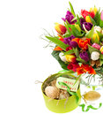 Bouquet of fresh tulips with easter eggs and gift box on white background holidays background Stock Images