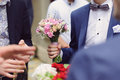 Bouquet in groom s hand elegant wedding Royalty Free Stock Images