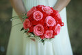 Bouquet in the hands of the bride delicate red rose wedding roses Stock Image