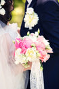 Bouquet in hands at the groom and  bride Royalty Free Stock Photo