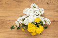 Bouquet of lilac and dandelions on the table Royalty Free Stock Photo