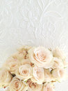 Bouquet miniature pastel roses white decorative background Royalty Free Stock Photos